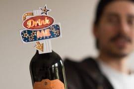 Insegna Drink Me per bottiglie